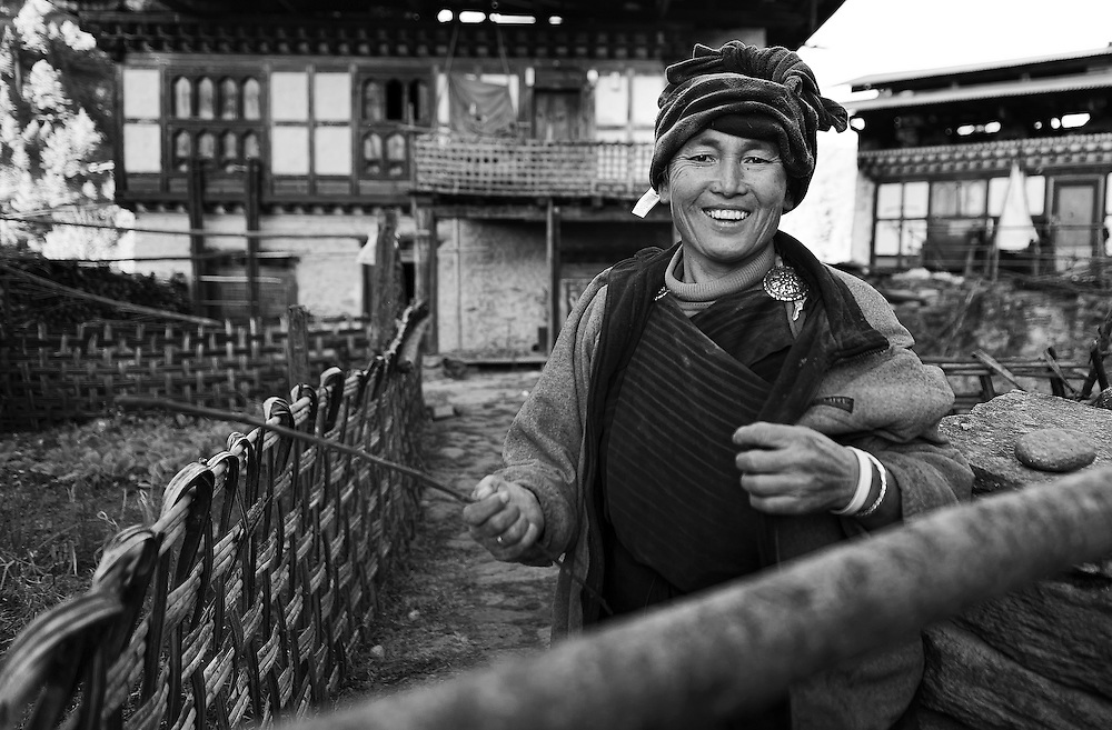 A woman outside her home in Bumthang Bhutan.