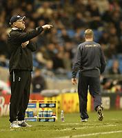 Photo: Aidan Ellis.<br /> Manchester City v Tottenham Hotspur. The Barclays Premiership. 17/12/2006.<br /> Spurs Boss Martin Jol with City's Stuart Pearce in the background