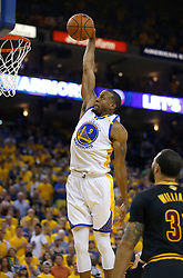 The Golden State Warriors' Andre Iguodala (9) dunks the ball against Cleveland Cavaliers' Deron Williams (31) in the second quarter of Game 5 of the NBA Finals at Oracle Arena in Oakland, Calif., on Monday, June 12, 2017. (Photo by Nhat V. Meyer/Bay Area News Group/TNS) *** Please Use Credit from Credit Field ***