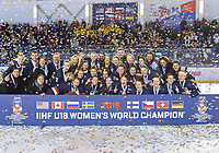 DMITROV, RUSSIA - JANUARY 13: Team USA celebrate with the championship trophy following a 9-3 win over team Sweden at the 2018 IIHF Ice Hockey U18 Women's World Championship. (Photo by Steve Kingsman/HHOF-IIHF Images)