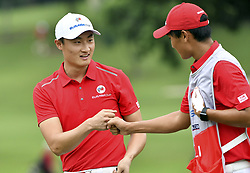 KUALA LUMPUR, Jan. 14, 2018  Team Asia's Li Haotong (L) reacts during the EurAsia Cup 2018 at the Glenmarie Golf and Country Club in Kuala Lumpur, Malaysia, on Jan. 14, 2018. Team Europe won 14-10. (Credit Image: © Chong Voon Chung/Xinhua via ZUMA Wire)