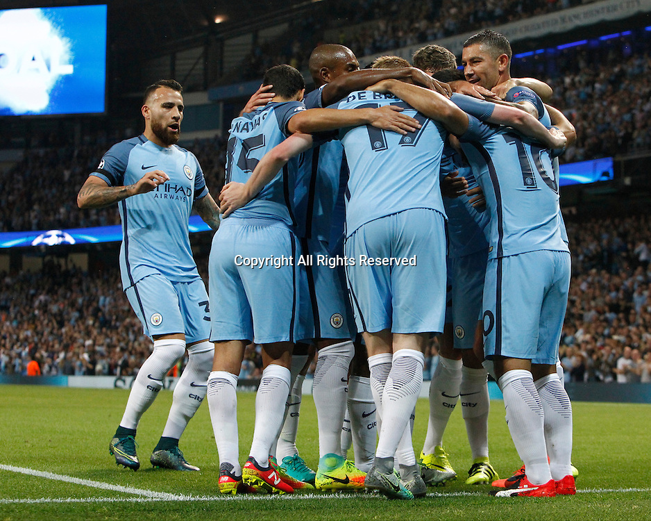 14.09.2016. The Etihad, Manchester, England. UEFA Champions League Football. Manchester City versus Borussia Monchengladbach. Manchester City striker Sergio Agüero (10) is congratulated by his team mates after scoring his team's first goal in the 8th minute 1-0.