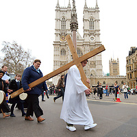 London April 10th - worshippers walking quietly behing the cross  along Victoria street in Westminster on Good Friday in Central London...Standard Licence feee's apply  to all image usage.Marco Secchi - Xianpix tel +44 (0) 845 050 6211 .e-mail ms@msecchi.com .http://www.marcosecchi.com