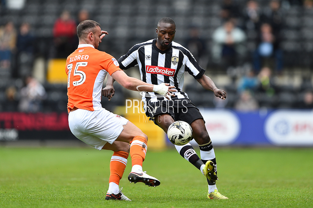 Notts County forward Shola Ameobi (9) battles with Blackpool defender Tom Aldred (15) during the EFL Sky Bet League 2 match between Notts County and Blackpool at Meadow Lane, Nottingham, England on 29 April 2017. Photo by Jon Hobley.