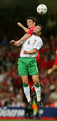 CARDIFF, WALES - Wednesday, September 8, 2004: Wales' Jason Koumas in action against Northern Ireland's Damien Johnson during the Group Six World Cup Qualifier at the Millennium Stadium. (Pic by David Rawcliffe/Propaganda)