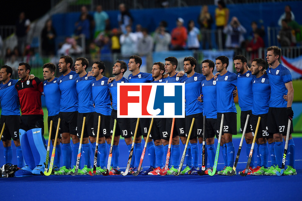 Argentina's players stand for the national anthems before the mens's field hockey Ireland vs Argentina match of the Rio 2016 Olympics Games at the Olympic Hockey Centre in Rio de Janeiro on August, 12 2016. / AFP / MANAN VATSYAYANA        (Photo credit should read MANAN VATSYAYANA/AFP/Getty Images)