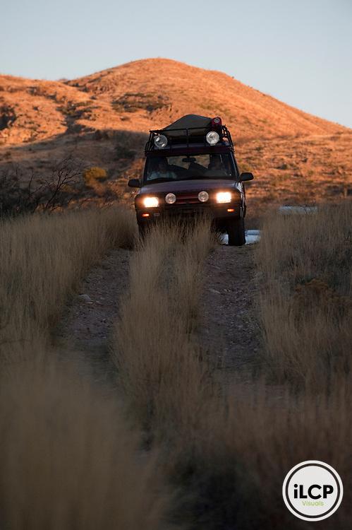 ILCP photographer Miguel Angel de la Cueva driving along dirt road.