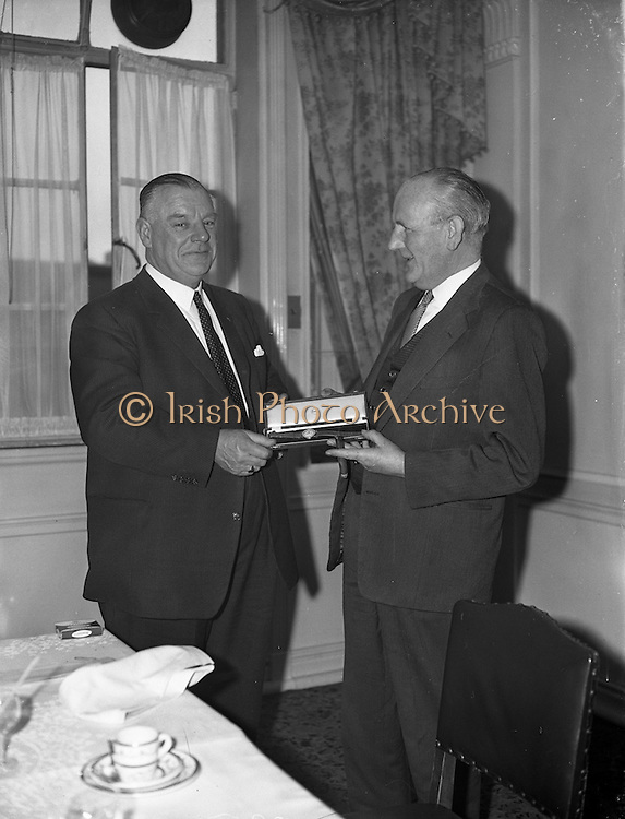 23/01/1962<br /> 01/23/1962<br /> 23 January 1962<br /> Long Service Award (25 years) of a watch presented to Mr. Hallwell, Dublin Maintenance Manager, Esso at the Gresham Hotel, Dublin. Mr Denis Dunne (left), Director at Esso Petroleum Company (Ireland) Ltd. presents Mr Hallwell with his watch.