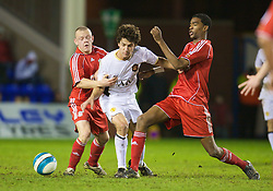 WARRINGTON, ENGLAND - Tuesday, February 26, 2008: Liverpool's Jay Spearing and Damien Plessis tackle and Manchester United's Rodrigo Possebon during the FA Premiership Reserves League (Northern Division) match at the Halliwell Jones Stadium. (Photo by David Rawcliffe/Propaganda)