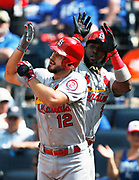 St. Louis Cardinals' Paul DeJong (12) celebrates with Marcell Ozuna (23) after hitting a two-run home run in the ninth inning of a baseball game at Kauffman Stadium in Kansas City, Mo., Sunday, Aug. 12, 2018. The Cardinals defeated the Royals 8-2.  (AP Photo/Colin E. Braley)