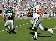 CHARLOTTE, NC - NOVEMBER 7:  Tight end Doug Jolley #88 of the Oakland Raiders catches a pass for a 33 yard gain against safety Mike Minter #30 of the Carolina Panthers at Bank of America Stadium on November 7, 2004 in Charlotte, North Carolina. The Raiders defeated the Panthers 27-24. ©Paul Anthony Spinelli  *** Local Caption *** Doug Jolley;Mike Minter