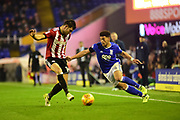 Birmingham City striker Che Adams (14) battles for possession with Brentford FC defender John Egan (14) during the EFL Sky Bet Championship match between Birmingham City and Brentford at St Andrews, Birmingham, England on 1 November 2017. Photo by Dennis Goodwin.