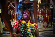 Jan. 24, 2016 - Kuala Lumpur, Batu Caves, Malaysia - <br /> <br /> Thaipusam Festival in Kuala Lumpur<br /> <br /> Hindu devotee possessed by the god reacts in a state of trance in the Batu caves. To mark this day, Hindus devotees pierce different part of their body with various metal skewers and carry pots of milk on their heads along couple of kilometers to celebrate the honor of Lord Subramaniam (Lord Murugan) in the Batu Caves, one of the most popular shrine outside India and the focal point to celebrate the Thaipusam Festival in Malaysia..Thaipusam is an annual Hindu festival, observed on the day of the full moon during the Tamil month of Thai, it is also a public holiday for many people. <br /> ©Exclusivepix Media