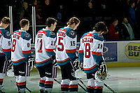 KELOWNA, CANADA, JANUARY 1: Cole Martin #8, Carter Rigby #11, Colton Sissons #15 and Shane McColgan #18 stand on the ice during the national anthem as the Calgary Hitmen visit the Kelowna Rockets on January 1, 2012 at Prospera Place in Kelowna, British Columbia, Canada (Photo by Marissa Baecker/Getty Images) *** Local Caption ***