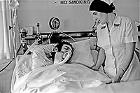 Pictured in Daisy Hill Hospital, Newry, Co Down, is Alan Black, the sole survivor of the Kingsmill Massacre in which 10 Protestant textile workers were shot dead by the Republican Action Force, generally accepted as a covername for the Provisional IRA. The Roman Catholic driver of the minibus also survived having been separated from the passengers who were then machine-gunned. 1976010014, 14/76.<br /> <br /> Copyright Image from Victor Patterson, 54 Dorchester Park, <br /> Belfast, UK, BT9 6RJ<br /> <br /> t1: +44 28 9066 1296 (from Rep of Ireland 048 9066 1296)<br /> t2: +44 28 9002 2446 (from Rep of Ireland 048 9002 2446)<br /> m: +44 7802 353836<br /> <br /> e1: victorpatterson@me.com<br /> e2: victorpatterson@gmail.com<br /> <br /> www.victorpatterson.com<br /> <br /> Please see my Terms and Conditions of Use at www.victorpatterson.com. It is IMPORTANT that you familiarise yourself with them.<br /> <br /> Images used on the Internet must be visibly watermarked i.e. © Victor Patterson within the body of the image and copyright metadata must not be deleted. Images used on the Internet have a size restriction of 4kbs and will be chargeable at current NUJ rates unless agreed otherwise.<br /> <br /> This image is only available for the use of the download recipient i.e. television station, newspaper, magazine, book publisher, etc, and must not be passed on to any third party. It is also downloaded on condition that each and every usage is notified within 7 days to victorpatterson@me.com<br /> <br /> The right of Victor Patterson to be identified as the author is asserted in accordance with The Copyright Designs And Patents Act (1988).