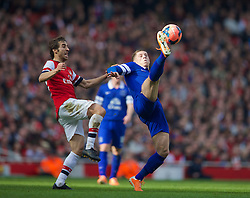 08.03.2014, Emirates Stadium, London, ENG, FA Cup, FC Arsenal vs FC Everton, Viertel Finale, im Bild Everton's Ross Barkley, action against Arsenal's Mathieu Flamini // during the English FA Cup quater final match between Arsenal FC and Everton FC at the Emirates Stadium in London, Great Britain on 2014/03/08. EXPA Pictures © 2014, PhotoCredit: EXPA/ Propagandaphoto/ David Rawcliffe<br /> <br /> *****ATTENTION - OUT of ENG, GBR*****