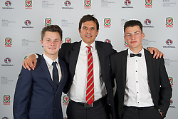 CARDIFF, WALES - Monday, October 5, 2015: Wales' manager Chris Coleman with young players Liam Cullen [L] and Regan Poole [R] during the FAW Awards Dinner at Cardiff City Hall. (Pic by Ian Cook/Propaganda)