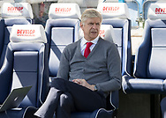 Arsene Wenger of Arsenal sits on the bench <br /> before the Premier League match at the John Smiths Stadium, Huddersfield<br /> Picture by James Wilson/Focus Images Ltd 07522 978714<br /> 13/05/2018