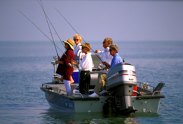 Stock photo of a group of enthusiasts enjoying an afternoon of fishing.