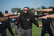 """Major League Umpire Ed Hickox, center, attended the Harry Wendelstedt Umpire School in Daytona Beach, Fla. as a student in 1983 and has been giving back as instructor for the last 30 years. """"Not only do I get to teach the students how to be better umpires,"""" said Hickox. """"I also get to teach the instructors how to be better teachers. And I love that."""""""