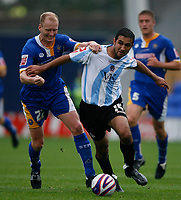 Photo: Steve Bond.<br /> Shrewsbury Town v Chesterfield. Coca Cola League 2. 13/10/2007. Jack Lester (R) has his shirt pulled by Colin Murdock (L)