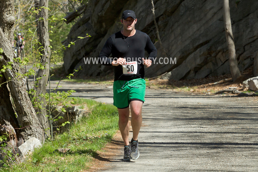 Gardiner, New York - Runners compete in the Rock the Ridge 50-mile endurance challenge race at the Mohonk Preserve on May 4, 2013. The race is part of Mohonk's 50th anniversary celebration and a fundraiser for the preserve.