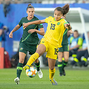 GRENOBLE, FRANCE June 18.  Toriana Patterson #19 of Jamaica is challenge by Chloe Logarzo #6 of Australia during the Jamaica V Australia, Group C match at the FIFA Women's World Cup at Stade des Alpes on June 18th 2019 in Grenoble, France. (Photo by Tim Clayton/Corbis via Getty Images)