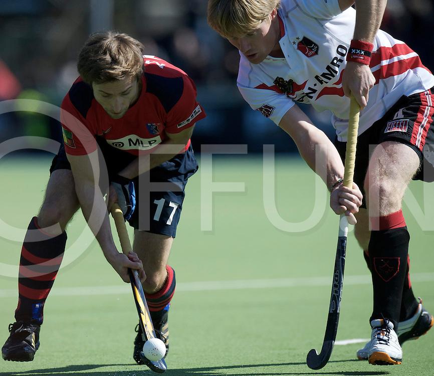 Amstelveen - Euro Hockey league KO16.Amsterdamse H&BC - Berliner HC.foto: Robert Marx (red) and Klaas Vermeulen (white)..FFU PRESS AGENCY COPYRIGHT FRANK UIJLENBROEK.