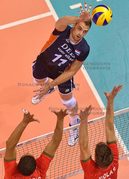 20150619 NED: World League Nederland - Portugal, Groningen<br /> De Nederlandse volleyballers hebben in de World League ook huneerste duel met Portugal met 3-0 gewonnen / Dick Kooy #11