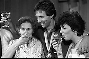1983-15-08.15th August 1983.15-08-1983.08-15-83.  .Photographed at Dublin Airport..The Gold and the bubbly:..Gold medalist Eamonn Coughlan celebrates in the VIP lounge of Dublin Airport with his wife Yvonne and his mother Kathleen on his return from the World Athletic Championships in Helsinki, Finland.