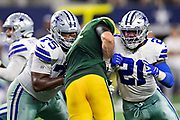 ARLINGTON, TX - OCTOBER 6:  Ezekiel Elliott #21 and Cameron Fleming #75 of the Dallas Cowboys double team on a block during a game against the Green Bay Packers at AT&T Stadium on October 6, 2019 in Arlington, Texas.  The Packers defeated the Cowboys 34-24.  (Photo by Wesley Hitt/Getty Images) *** Local Caption *** Ezekiel Elliott; Cameron Fleming