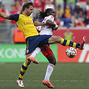 Francis Coquelin, (left), Arsenal, challenged by Péguy Luyindula, New York Red Bulls, during the New York Red Bulls Vs Arsenal FC,  friendly football match for the New York Cup at Red Bull Arena, Harrison, New Jersey. USA. 26h July 2014. Photo Tim Clayton