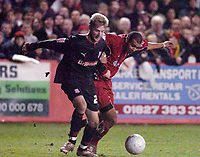 Photo: Leigh Quinnell.<br /> Tamworth v Stoke City. The FA Cup. 17/01/2006. Tamworths Jimmy Turner is kept from goal by Stokes Paul Gallagher.