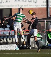 26th December 2017, Dens Park, Dundee, Scotland; Scottish Premier League football, Dundee versus Celtic; Dundee's Mark O'Hara competes in the air with Celtic's Kieran Tierney