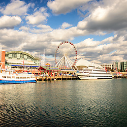 Navy Pier Chicago picture with the Ferris Wheel and tour boats along Lake Michigan. Image Copyright © Paul Velgos All Rights Reserved.