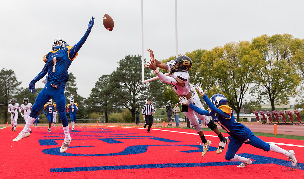 Omaha Burke's Chris Hickman dives for a pass as Omaha North's Ronniel wells, No. 1, and Vernon Johnson, No. 21, defend in the second quarter. Offensive pass interference was called on Burke. Omaha Northwest played Omaha Burke in a high school football game at Kinnick Stadium on Friday, Oct. 6, 2017, in Omaha.<br /> <br /> MATT DIXON/THE WORLD-HERALD
