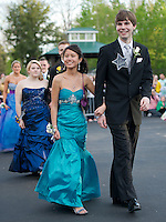 "James Guyer and his date Lily Chantitaske march at Meadowbrook for the Laconia High Schools ""Grammy"" themed prom Friday evening.  (Karen Bobotas/for the Laconia Daily Sun)"