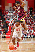 BLOOMINGTON, IN - JANUARY 12: Remy Abell #23 of the Indiana Hoosiers dribbles around Maverick Ahanmisi #13 of the Minnesota Golden Gophers at Assembly Hall on January 12, 2012 in Bloomington, Indiana. Minnesota defeated Indiana 77-74. (Photo by Joe Robbins)