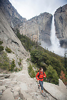 Young woman hiking Yosemite Falls Trail. Yosemite National Park, CA.