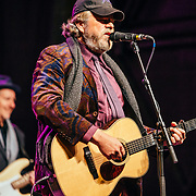 Robert Earl Keen performs to a packed crowd in Jackson, Wyoming. Portrait - Robert Earl Keen and Bill Whitbeck on stage.