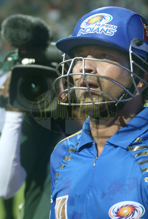 Sachin Tendulkar returns to the pavilion after his match winning knock in  match 8 of the the Indian Premier League ( IPL ) Season 4 between the Royal Challengers Bangalore and the Mumbai Indians held at the Chinnaswamy Stadium, Bangalore, Karnataka, India on the 12th April 2011..Photo by Vino John/BCCI/SPORTZPICS