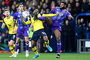 Charlton Athletic defender Adedeji Oshilaja (4) kicks Oxford United midfielder Tarique Fosu-Henry  (11) in the face , foul during the EFL Sky Bet League 1 match between Oxford United and Shrewsbury Town at the Kassam Stadium, Oxford, England on 7 December 2019.