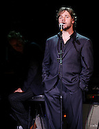Russell Crowe tells a story as Sting listens during the Rainforest Foundation's benefit concert at Carnegie Hall in New York May 19, 2006. Photo By Keith Bedford