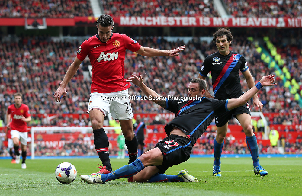 14th September 2013 - Barclays Premier League - Manchester United v Crystal Palace - Damien Delaney of Palace tackles Robin van Persie of Man Utd - Photo: Simon Stacpoole / Offside.