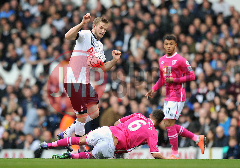 Eric Dier of Tottenham Hotspur is challenged by Andrew Surman of Bournemouth - Mandatory by-line: Paul Knight/JMP - Mobile: 07966 386802 - 20/03/2016 -  FOOTBALL - White Hart Lane - London, England -  Tottenham Hotspur v AFC Bournemouth - Barclays Premier League