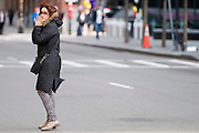 A woman stands in the street shortly after two explosions on Boylston Street in Boston on April 15, 2013. Three people were killed by the explosions, near the finish line of the Boston Marathon, in which 27,000 people competed.