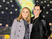 """Melissa Etheridge poses for a photo with her partner Linda Wallem, creator of Showtimes series Nurse Jackie at NMWA in front of one of Melissa favorite paintings by Hollis Sigler called """"To Kiss The Spirits"""" at the National Museum of Women in the Arts in Washington DC. Sunday Nov. 4th. Grammy award winner Melissa Etheridge was presented with The Excellence in the Performing Arts award from the National Museum of Women in the Arts (NMWA). Etheridge  also performed on the piano and then an acoustic set on guitar for an intimate audience of about 400 people. Photo ©Suzi Altman/For NMWA Grammy award winner Melissa Etheridge is presented with the National Museum of Women in the Arts' (NMWA) Award for Excellence in the Performing Arts in Washington DC. Sunday Nov. 4, 2012. Etheridge also performed on the piano and then an acoustic set on guitar for an intimate audience of about 300 people. Photo ©Suzi Altman/For NMWA<br /> <br /> Melissa Etheridge NMWA Award for Excellence in the Performing Arts"""
