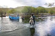 TERELJ, MONGOLIA..09/04/2001.ZIL truck stuck in the middle of a river..(Photo by Heimo Aga)