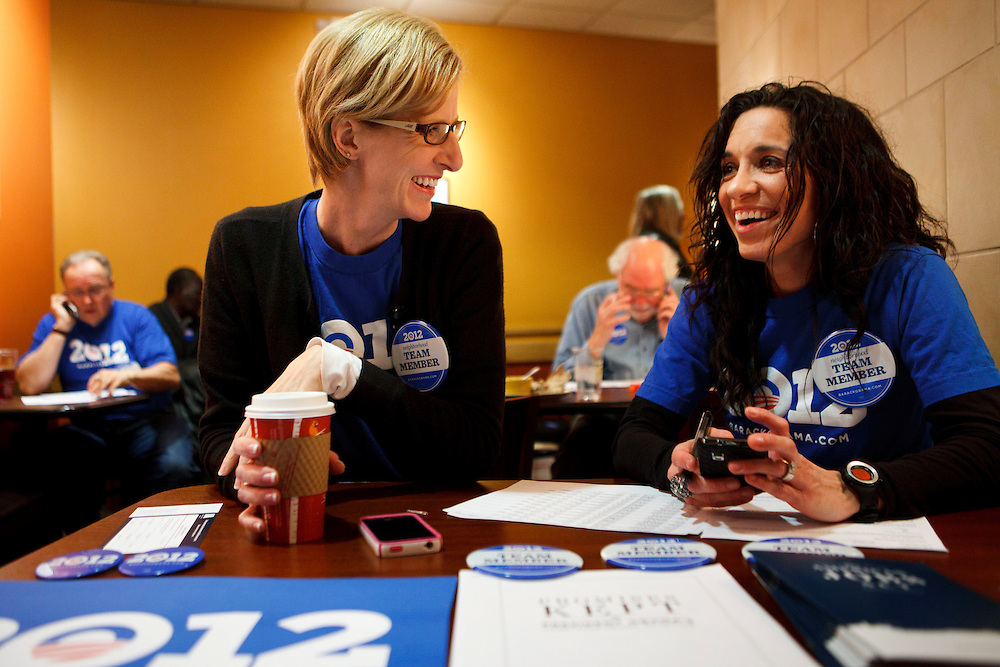 Tammy Engel-Meyer, left, and Kelly Tracy, both of Johnston, laugh together during an Organizing For America phone bank leading up to the caucuses at a local Panera on Thursday, December 22, 2011 in Johnston, Iowa. Patrick T. Fallon/For The New York Times