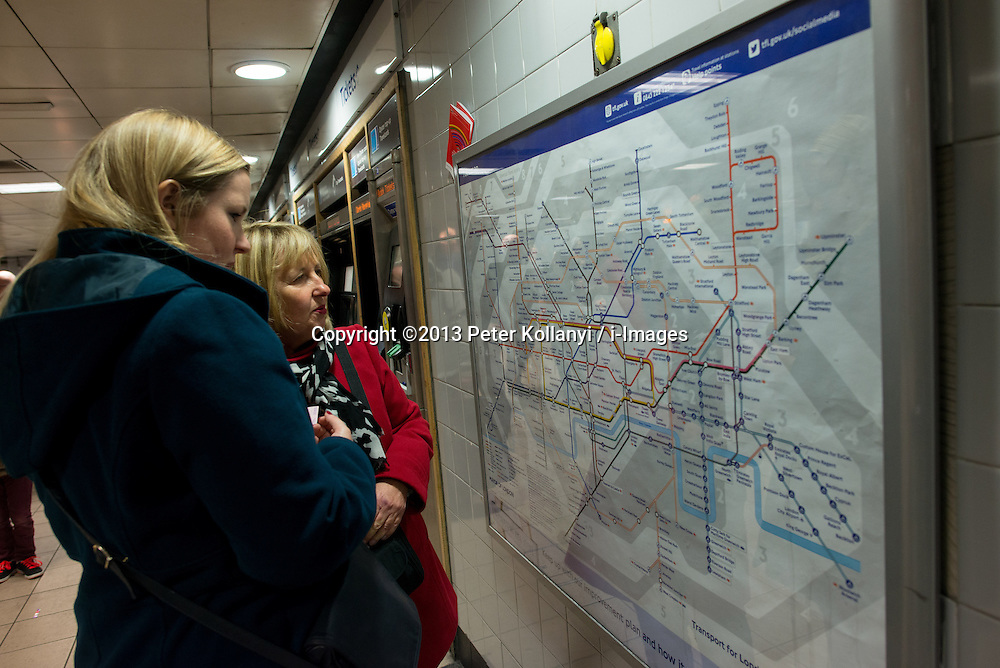 Ticket Office Job Cuts. Passengers look at Tube map at Euston ticket station. London Underground will run weekend services 24 hours under plans that also involve ticket office closures and up to 750 job cuts.Euston Station, London, United Kingdom. Thursday, 21st November 2013. Picture by Peter Kollanyi / i-Images